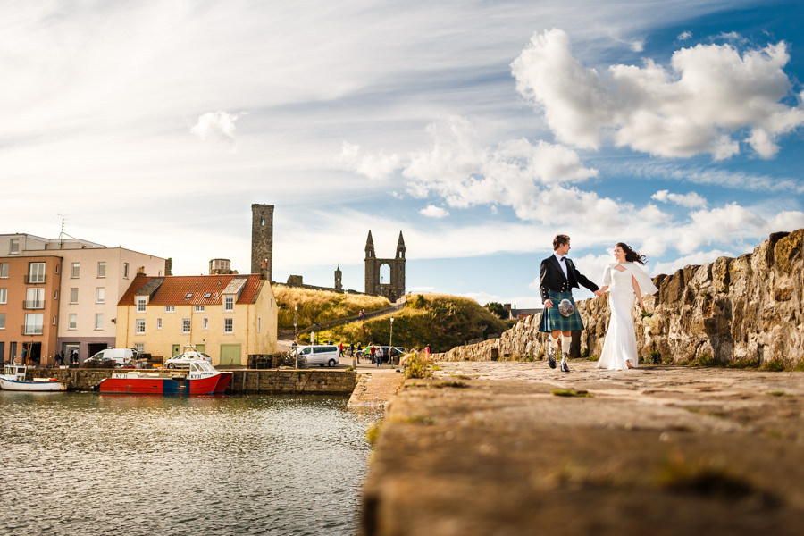 Wedding couple on pier by Edinburgh wedding photographer Hamish Robb