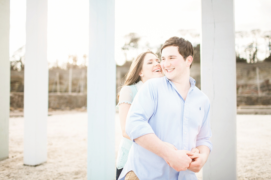 Spring Engagement shoot at Dysart Harbour in Fife - couple hug by sea front