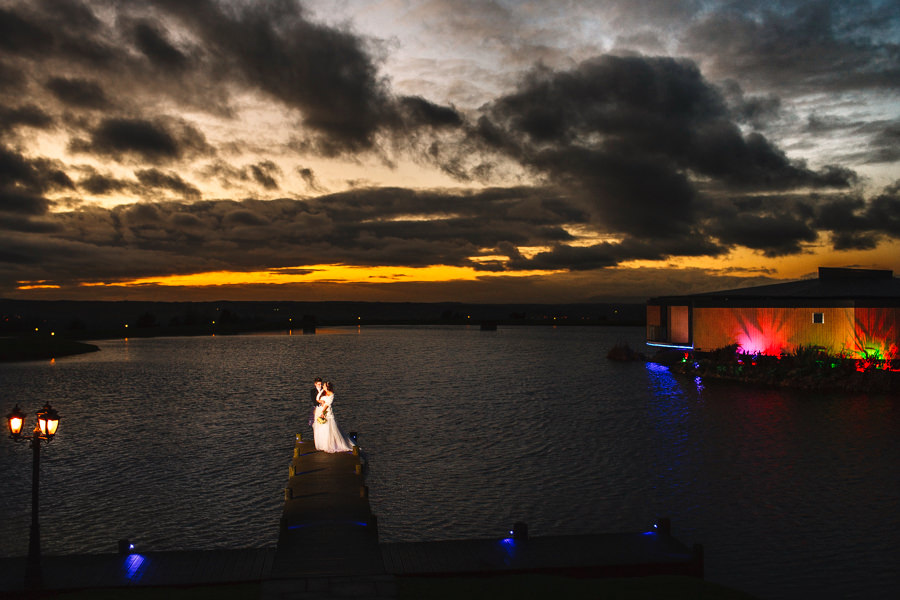 Winter wedding photography at The Vu in Bathgate - portait of bride and groom overlooking loch