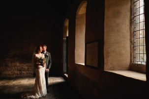 bride and groom pose in innerpeffray chapel