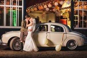 errol park wedding - couple kiss by wedding car